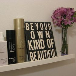 """""""Be Your Own Kind of Beautiful"""" is the """"ongoing philosophy of the salon,"""" said Lipe. The space also showcases and sells art made by clients."""