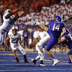 Justin Blackmore of the Brigham Young Cougars pressures punter Trevor Harman of the Boise State Broncos during NCAA football in Boise, Thursday, Sept. 20, 2012.
