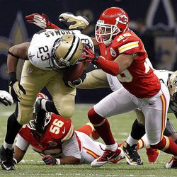 New Orleans Saints running back Pierre Thomas (23) is tackled by Kansas City Chiefs cornerback Stanford Routt (26) in the first half of an NFL football game in New Orleans, Sunday, Sept. 23, 2012.