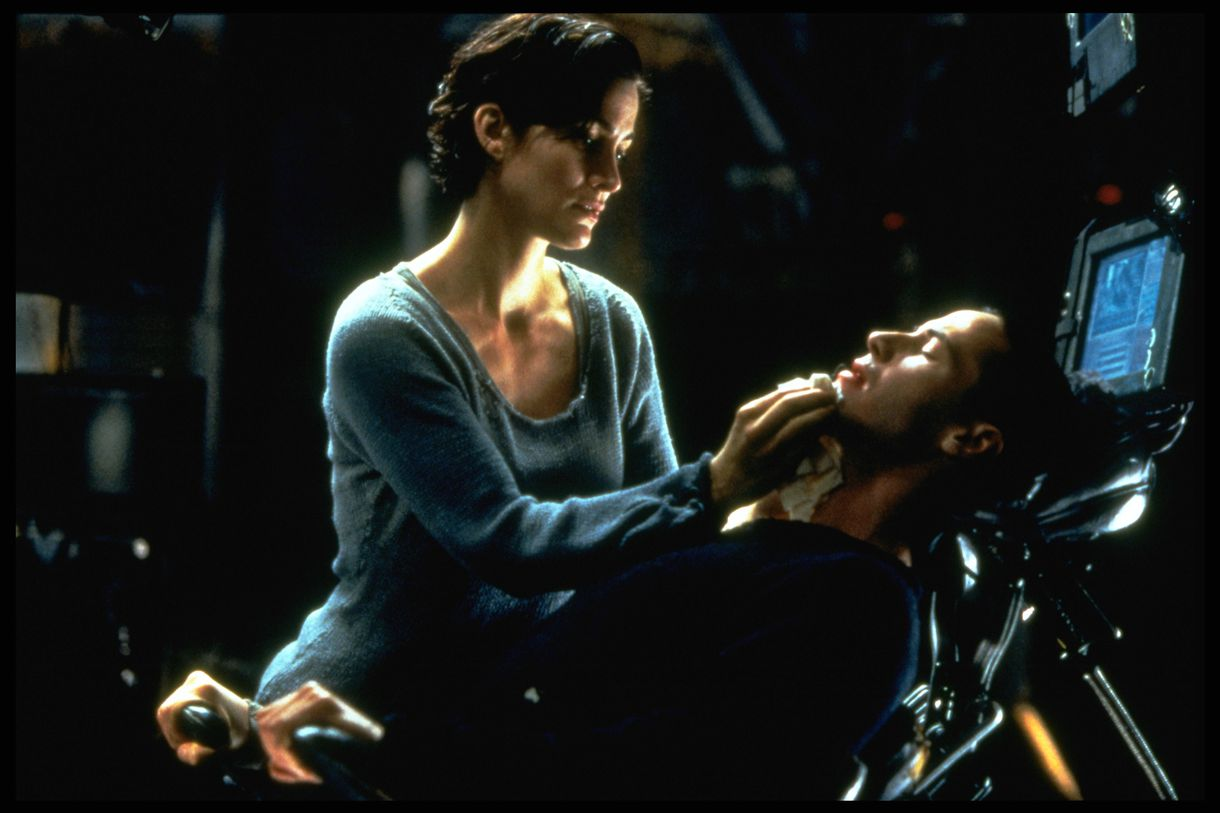 Carrie-Anne Moss and Keanu Reeves star in The Matrix.
