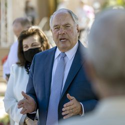 Elder Ronald A. Rasband, of the Quorum of the Twelve Apostles of The Church of Jesus Christ of Latter-day Saints, talks with members of the media and others while conducting a tour of the newly renovated Mesa Arizona Temple in Mesa, Ariz., on Monday, Oct. 11, 2021.