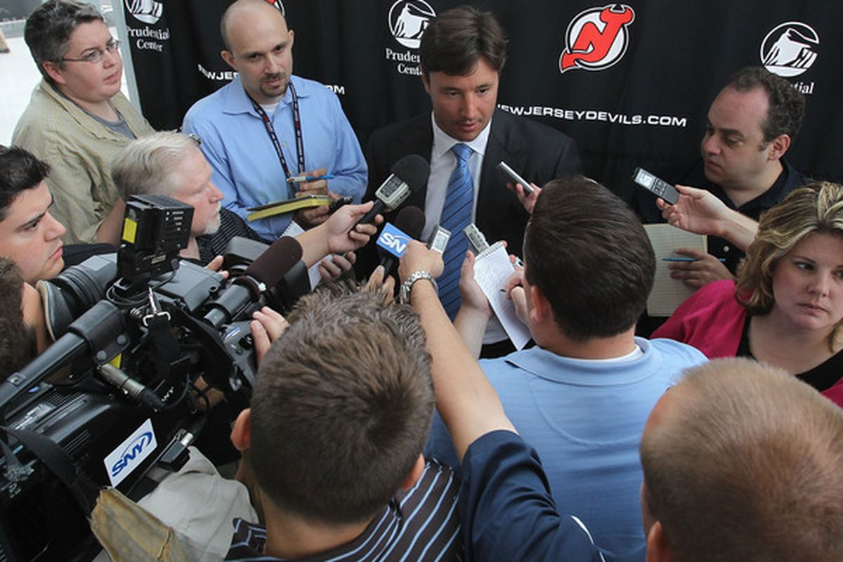 NEWARK NJ - JULY 20: Ilya Kovalchuk of the New Jersey Devils speaks with the media after announcing his contract renewal at the Prudential Center on July 20 2010 in Newark New Jersey. (Photo by Bruce Bennett/Getty Images)
