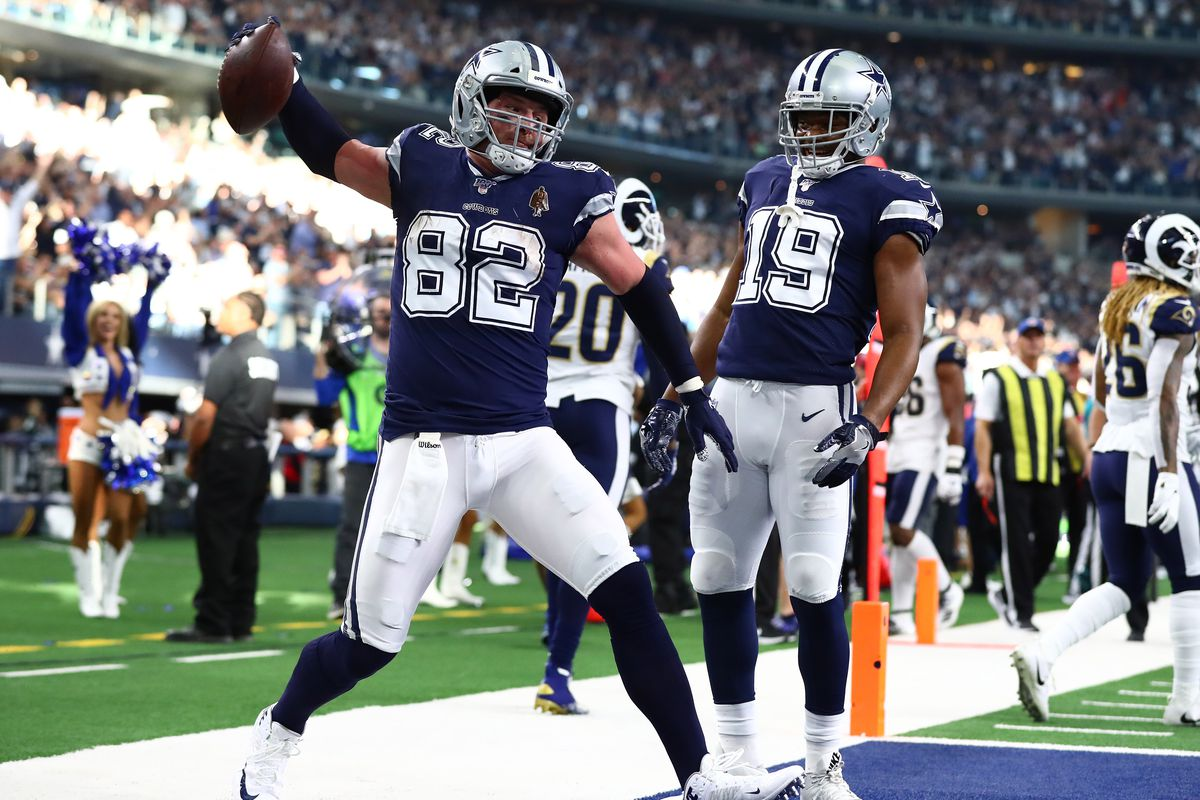 Dallas Cowboys tight end Jason Witten (82) spikes to ball while celebrating his first quarter touchdown with receiver Amari Cooper (19) against the Los Angeles Rams at AT&T Stadium.