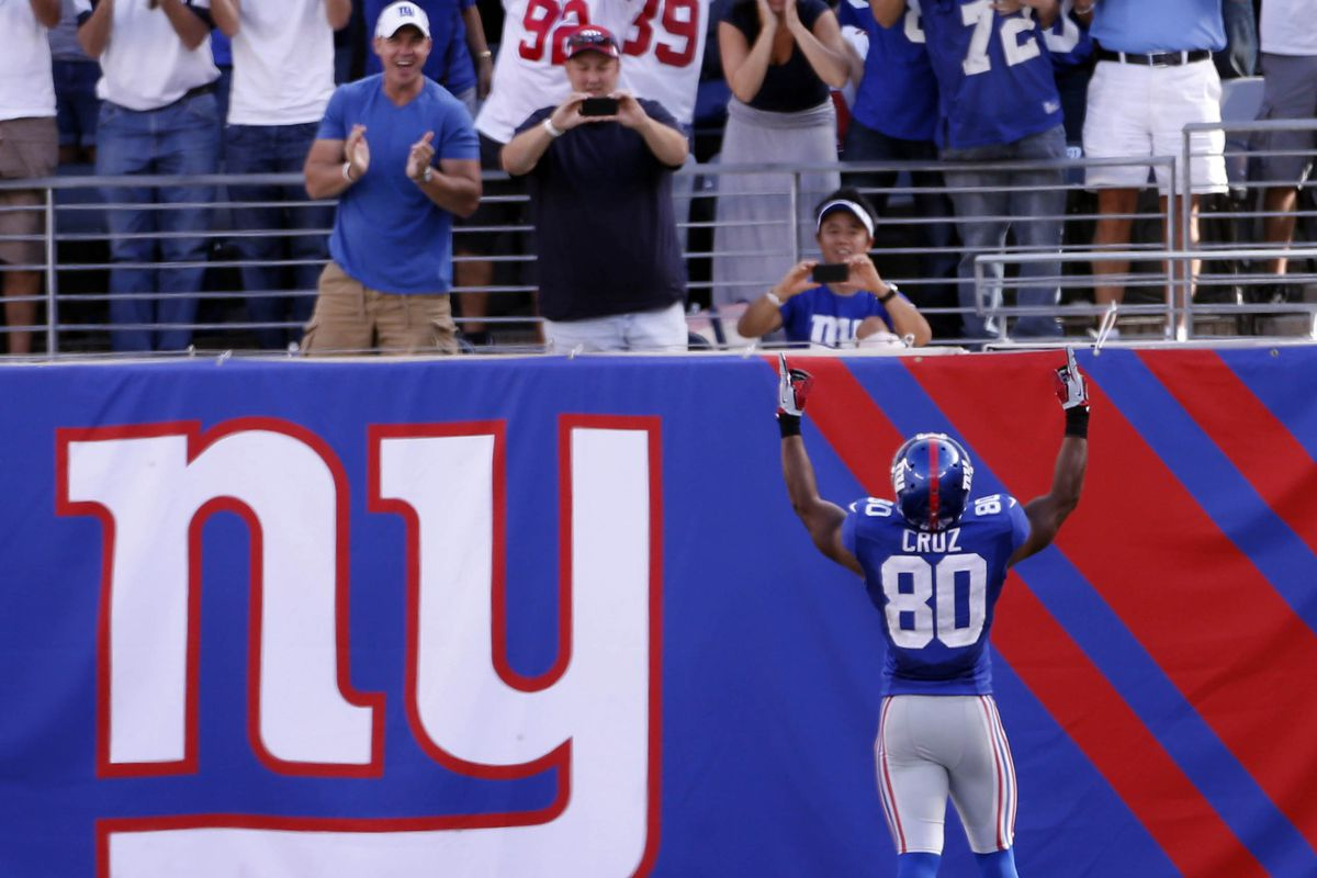 Sep 16, 2012; East Rutherford, NJ, USA; New York Giants wide receiver Victor Cruz (80) celebrates a touchdown against the Tampa Bay Buccaneers during the game at MetLife Stadium. Andrew Mills/THE STAR-LEDGER via US PRESSWIRE