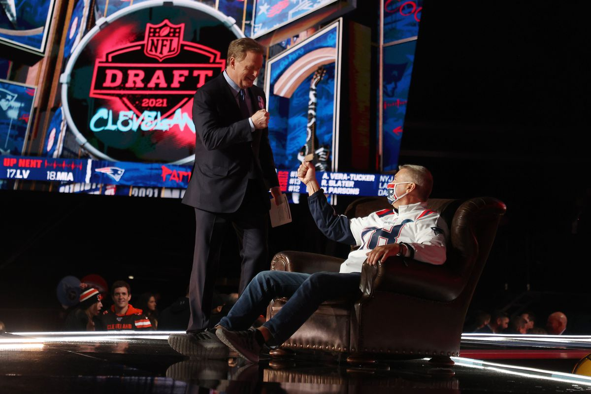 NFL Commissioner Roger Goodell greets a fan onstage during round one of the 2021 NFL Draft at the Great Lakes Science Center on April 29, 2021 in Cleveland, Ohio.