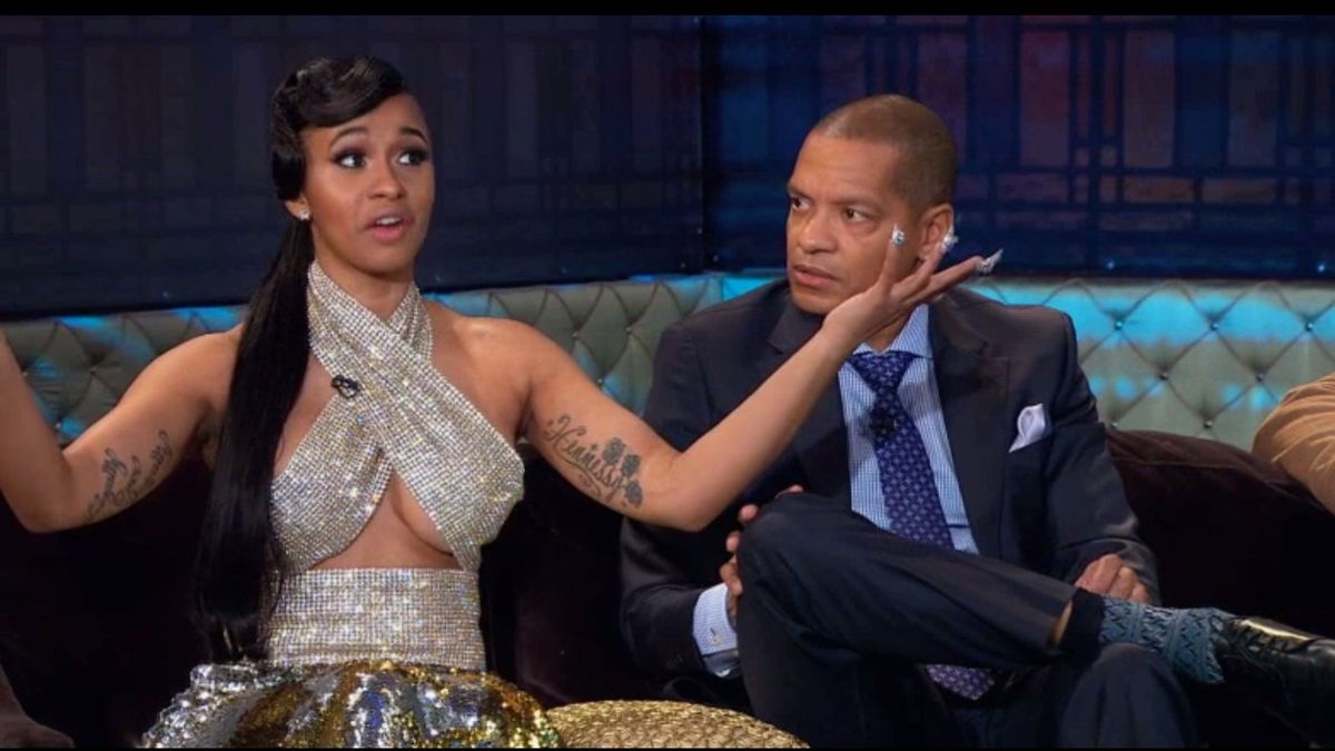 Cardi B and Peter Gunz sit on the couch of Love and Hip Hop: New York reunion