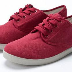 """<strong>Zig Zag</strong> Red Low Tops, <a href=""""http://statusfoe.com/products-page/zigzag-shoes/red-low-top-new/"""">$26</a> at <a href=""""http://www.welcomestranger.com"""">Welcome Stranger</a>"""