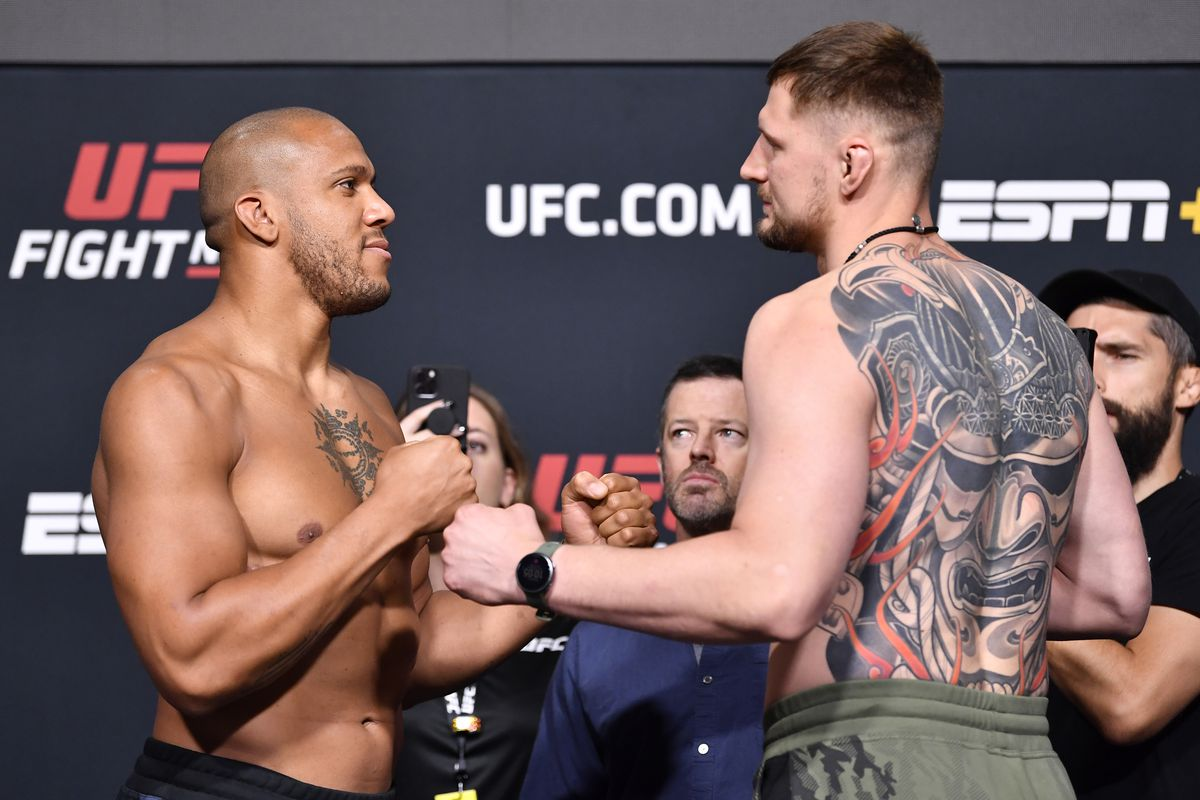 In this UFC handout, opponents Ciryl Gane of France and Alexander Volkov of Russia face off during the UFC weigh-in at UFC APEX on June 25, 2021 in Las Vegas, Nevada.