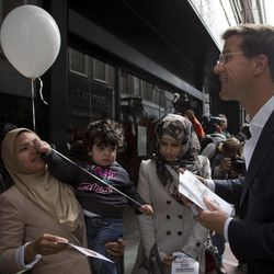 Dutch Prime Minister Mark Rutte, right, campaigns in a shopping street on the eve of parliamentary elections in The Hague, Netherlands, Tuesday Sept. 11, 2012. According to a summary of recent polls compiled by national broadcaster NOS Tuesday, Rutte's free-market VVD party is running neck-and-neck with the center-left Labor Party PvdA of Diedrik Samsom.