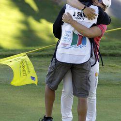 Jiyai Shin, of South Korea, hugs her caddy as she celebrates winning the Kingsmill Championship LPGA Tour golf tournament in Williamsburg, Va., Monday, Sept. 10, 2012.  Shin won the tournament in a nine-hole playoff with Paula Creamer.