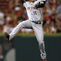 New York Mets shortstop Ruben Tejada tries but cannot throw out St. Louis Cardinals' Yadier Molina at first during the second inning of a baseball game Tuesday, Sept. 4, 2012, in St. Louis. The single was Molina's 1,000th career hit.