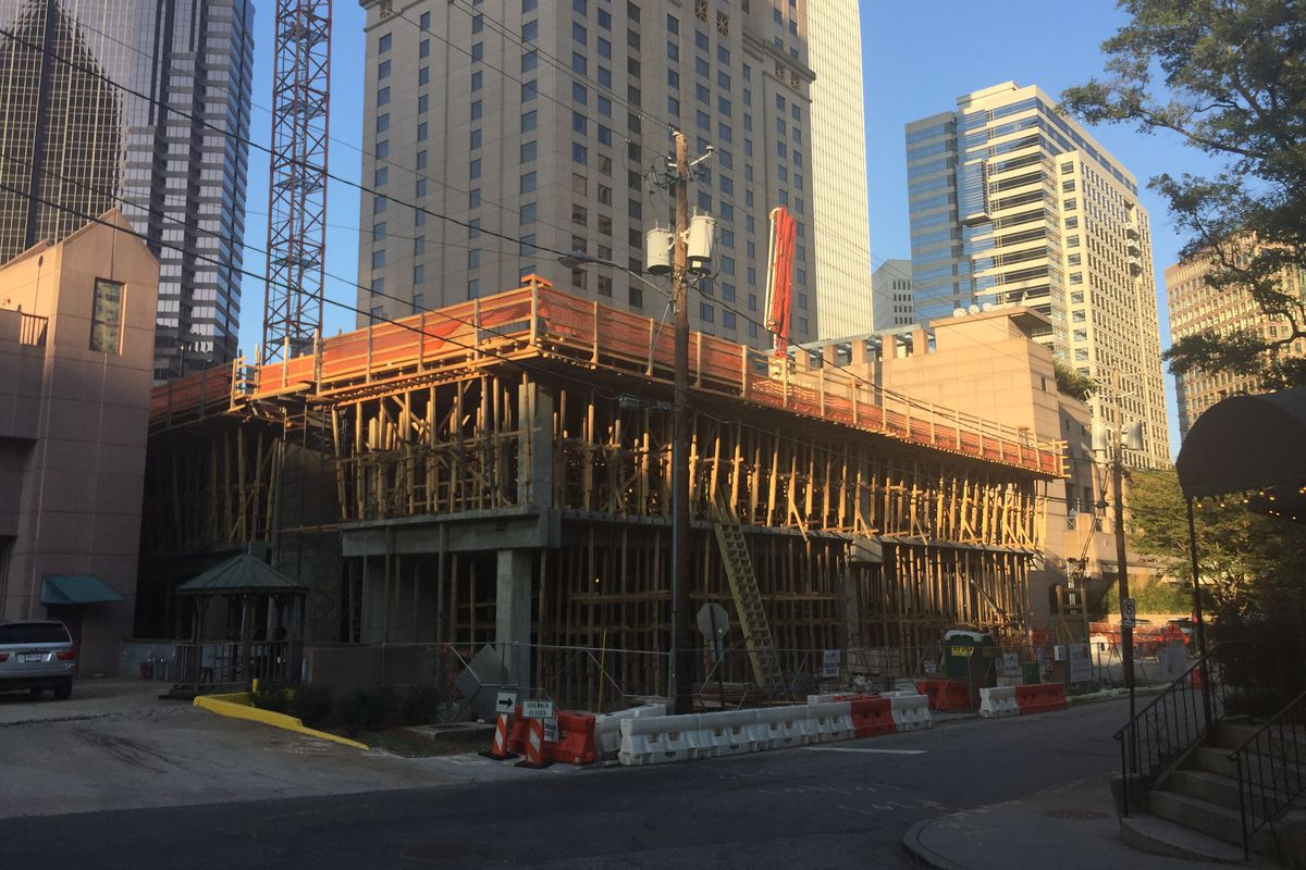 Formwork and concrete rising two stories.
