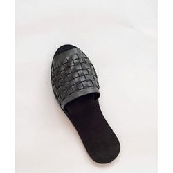 Suede, soft leather, and calf hair are among the customizable options for these made-to-order-slides.