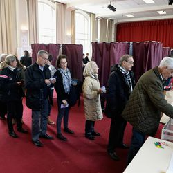 Parisians vote in municipal elections on March 23, 2014.
