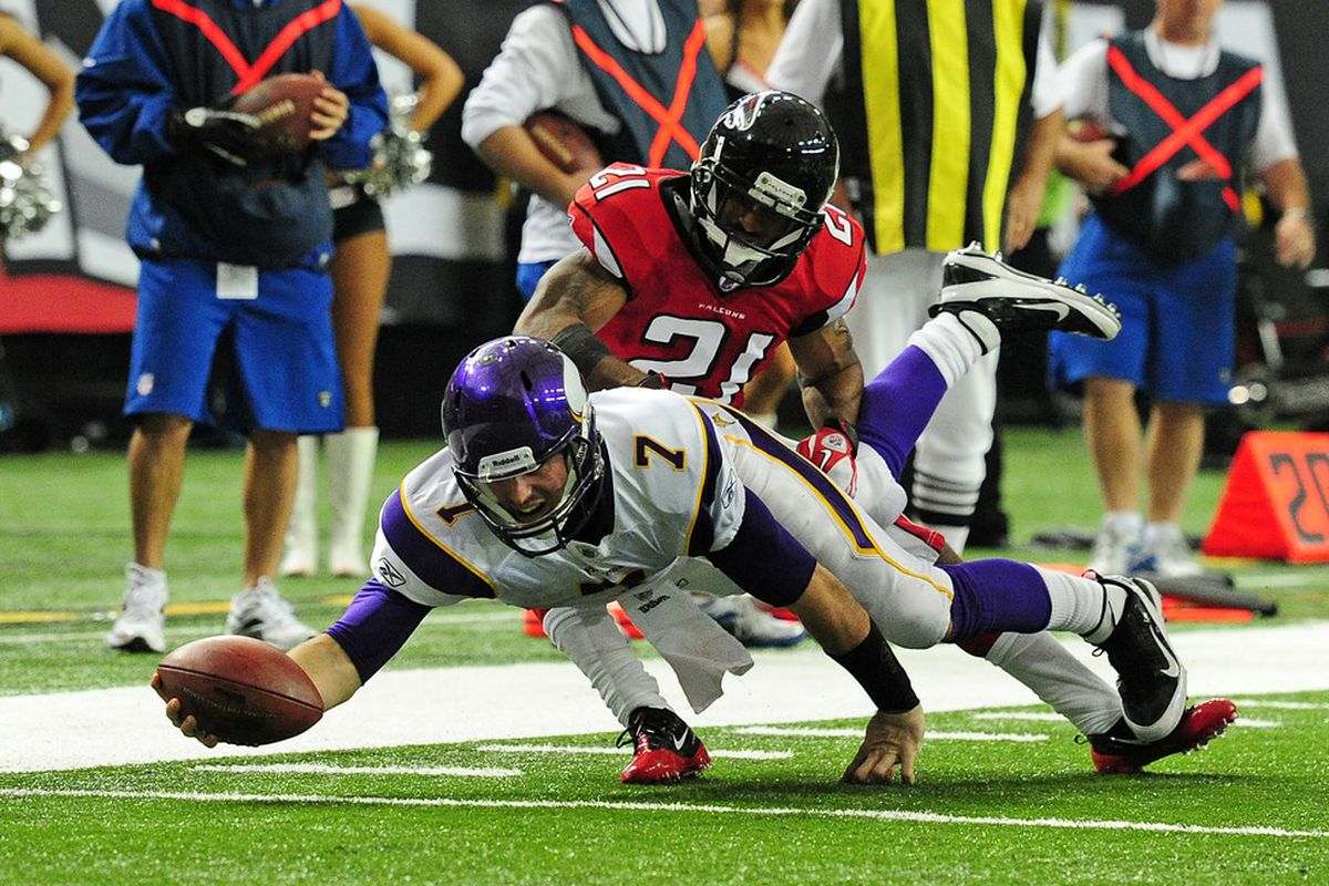 ATLANTA, GA - NOVEMBER 27: Christian Ponder #7 of the Minnesota Vikings dives for a first down against Chris Owens #21 of the Atlanta Falcons at the Georgia Dome on November 27, 2011 in Atlanta, Georgia. (Photo by Scott Cunningham/Getty Images)