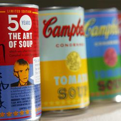 FILE-In this Aug. 24, 2012, photo, new limited edition Campbell's tomato soup cans with art and sayings by artist Andy Warhol are displayed at Campbell Soup Company in Camden, N.J. Campbell Soup Co. announced Tuesday, Sept. 4, 2012, that net income rose 27 percent in its fiscal fourth quarter. The results beat analysts' expectations and the food maker gave fiscal 2013 revenue guidance above Wall Street's view.
