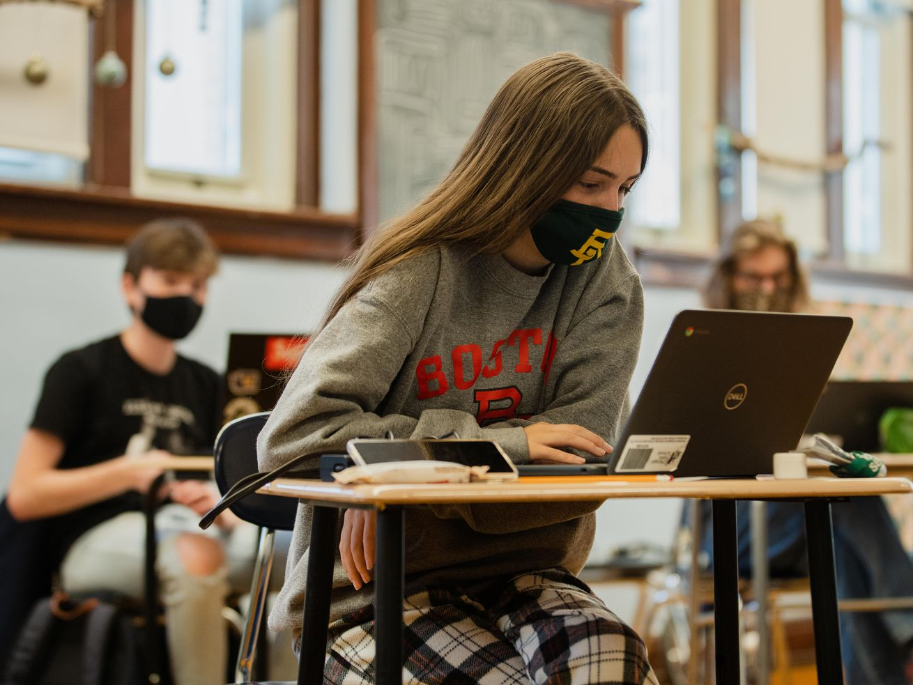 An IB History student looks at a laptop at Nicholas Senn High School in the Edgewater neighborhood, Friday afternoon, April 23, 2021. All students and staff, regardless of vaccination status, will be required to wear masks next school year.