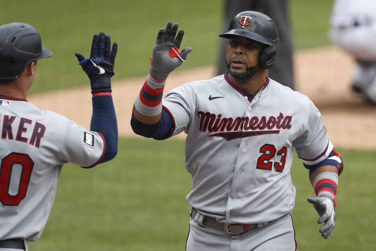 Minnesota Twins designated hitter Nelson Cruz celebrates with left fielder Brent Rooker after hitting a solo home run during the fifth inning against the Detroit Tigers at Comerica Park.
