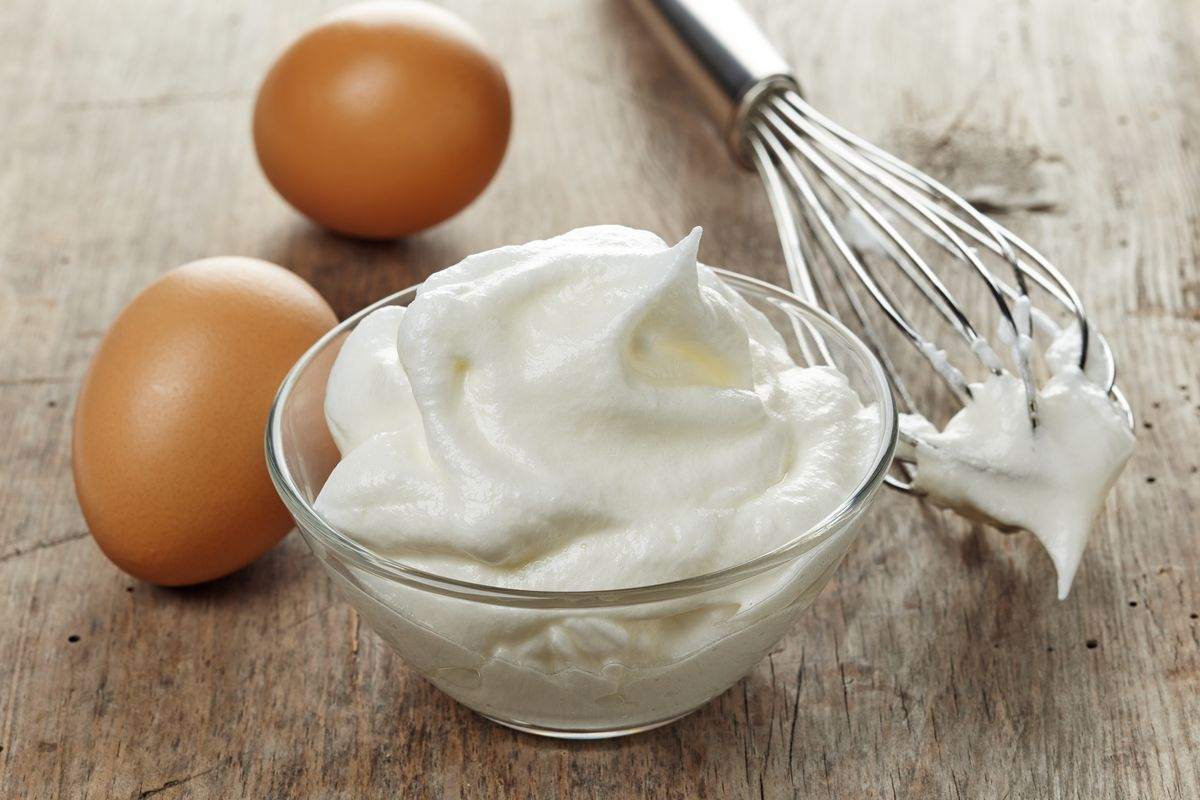 One of the key ingredients in cloud bread are the egg whites of three eggs, beaten until stiff peaks form.