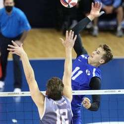 BYU's Zach Eschenberg goes up for the ball with Pepperdine's Jacob Steele trying for the block as BYU and Pepperdine play in the finals of the Mountain Pacific Sports Federation Championship, at the Smith Field House in Provo on Saturday, April 24, 2021. BYU won in straight sets.
