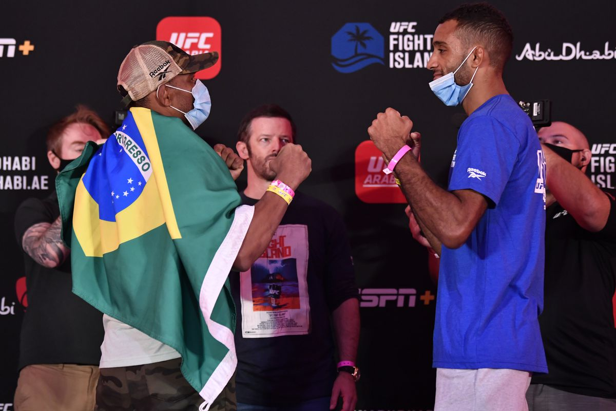 Opponents Francisco Trinaldo of Brazil and Jai Herbert of England face off during the UFC Fight Night weigh-in inside Flash Forum on UFC Fight Island on July 24, 2020 in Yas Island, Abu Dhabi, United Arab Emirates.