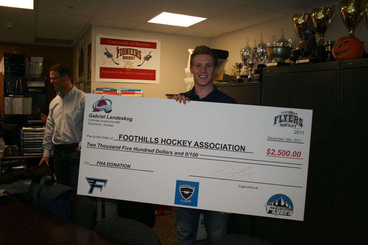 Gabriel Landeskog donates to local Denver charity on December 18, 2011. (C. Bradley, S. Gauthier)