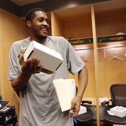 Utah Jazz power forward Derrick Favors (15) cleans out his locker for the season in Salt Lake City on April 18.
