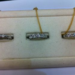 The 1.56 oval diamond wedding band on the far right is marked down to $2920 (from $7300)<br />