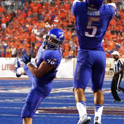 Jamar Taylor (5) of the Boise State Broncos, right, makes an interception against BYU during NCAA football in Boise, Thursday, Sept. 20, 2012. J.C. Percy (48) of the Boise State Broncos is at left.