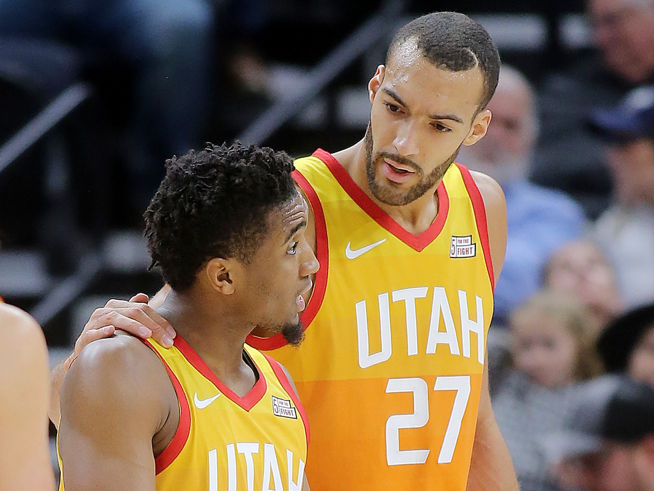 Utah Jazz center Rudy Gobert, right, talks to teammate Donovan Mitchell as the Utah Jazz and the Golden State Warriors play at Vivint Smart Home Arena in Salt Lake City on Wednesday, Dec. 19, 2018.
