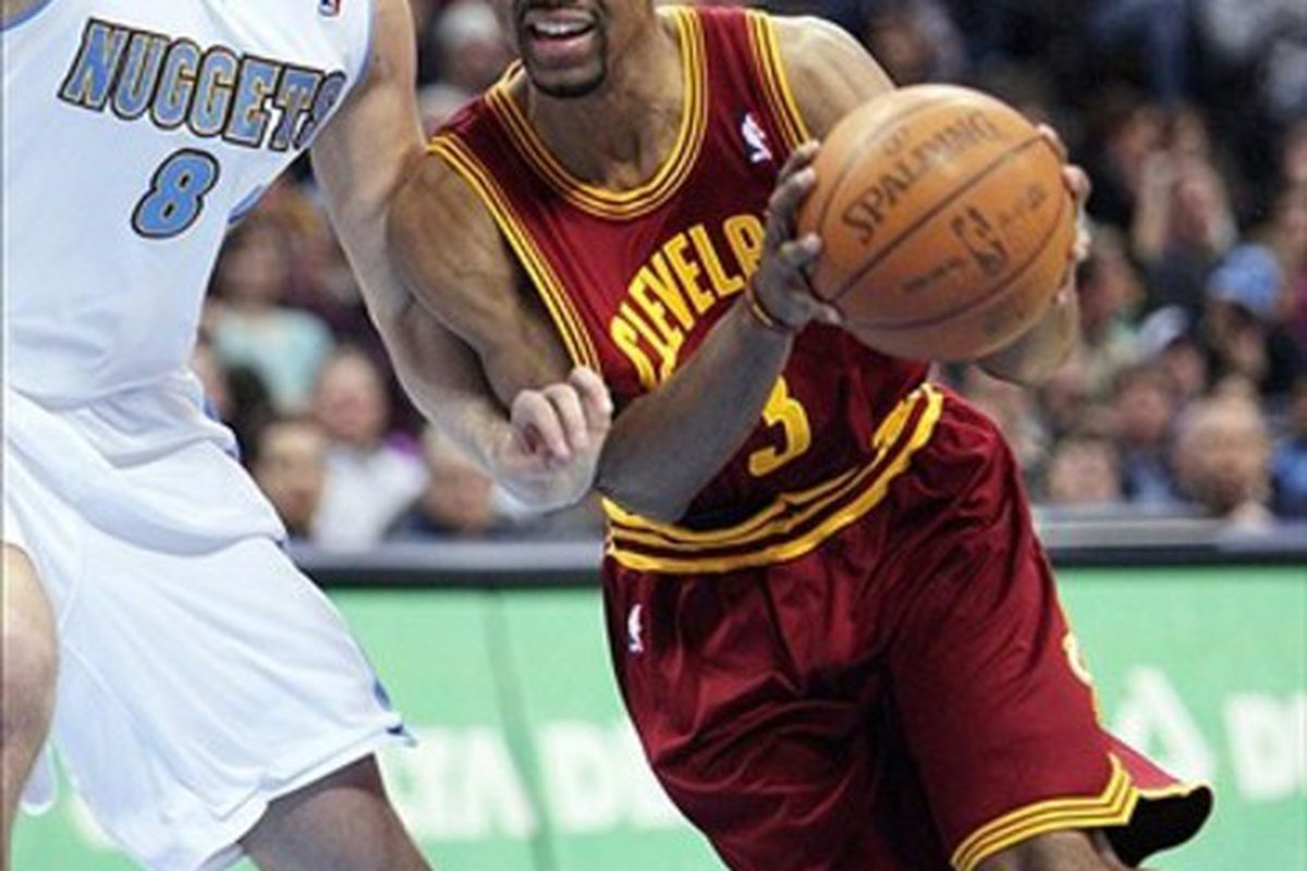 March 7, 2011; Denver, CO, USA; Cleveland Cavilers guard Ramon Sessions (3) drives to the basket against Denver Nuggets Danilo Gallianari (8) during the third quarter at the Pepsi Center.  Mandatory Credit: Chris Humphreys-US PRESSWIRE