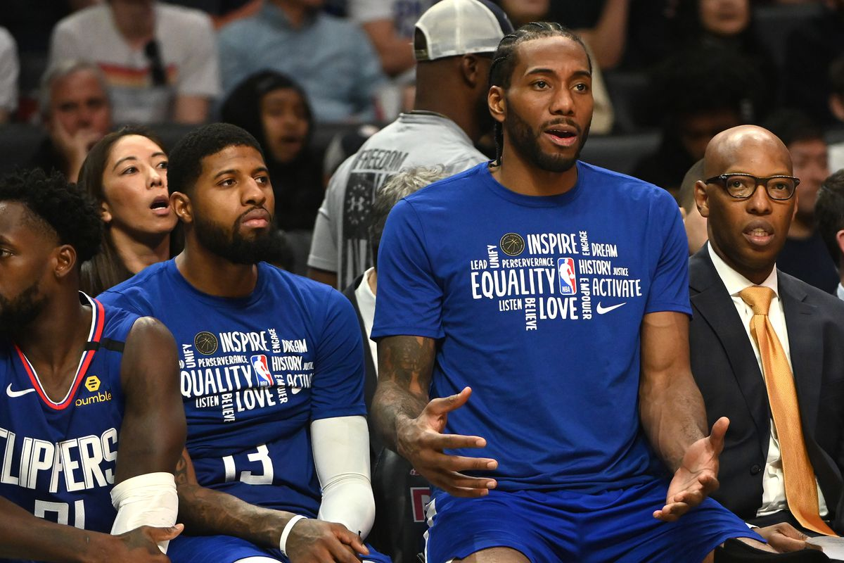 Los Angeles Clippers guard Paul George and forward Kawhi Leonard watch the 4th quarter of the game against the Minnesota Timberwolves at Staples Center.