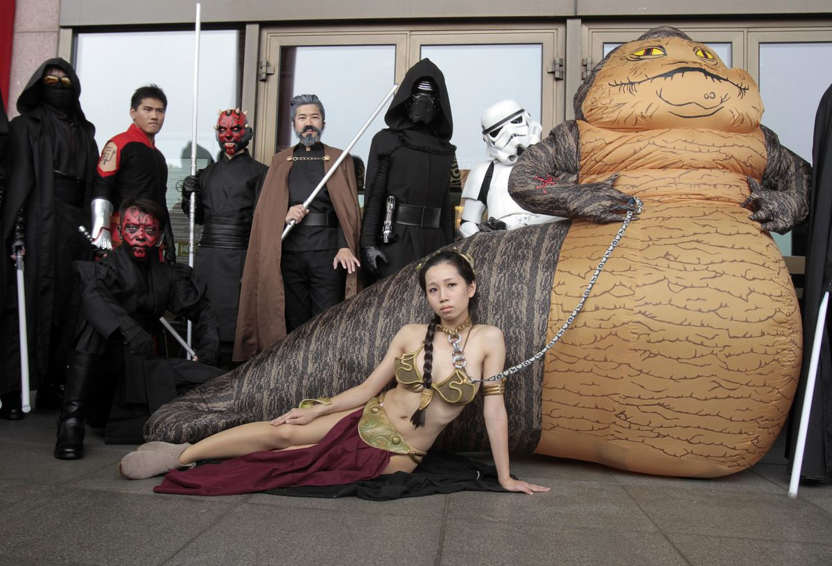 Fans dressed as movie Star Wars characters pose as they celebrate Star Wars Day in Taiwan on Wednesday.   Chiang Ying-ying/Associated Press