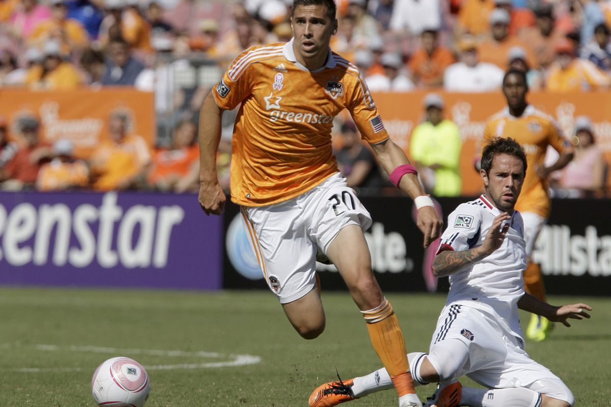 HOUSTON, TX - OCTOBER 01: Geoff Cameron #20 of the Houston Dynamo makes a move around Daniel Paladini #11of the Chicago Fire on October 1, 2011 at Robertson Stadium in Houston, Texas. (Photo by Thomas B. Shea/Getty Images)