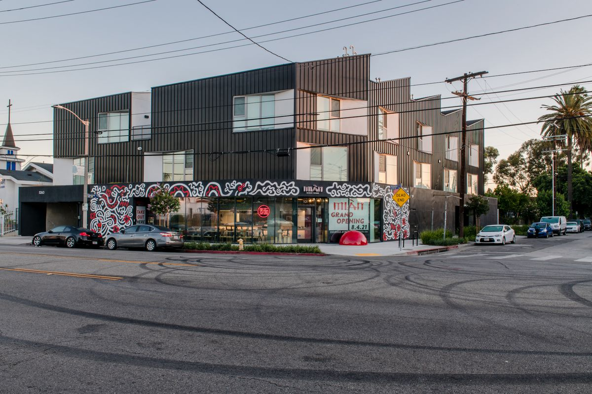 An evening look at a mixed use development and new mural at a redone restaurant.