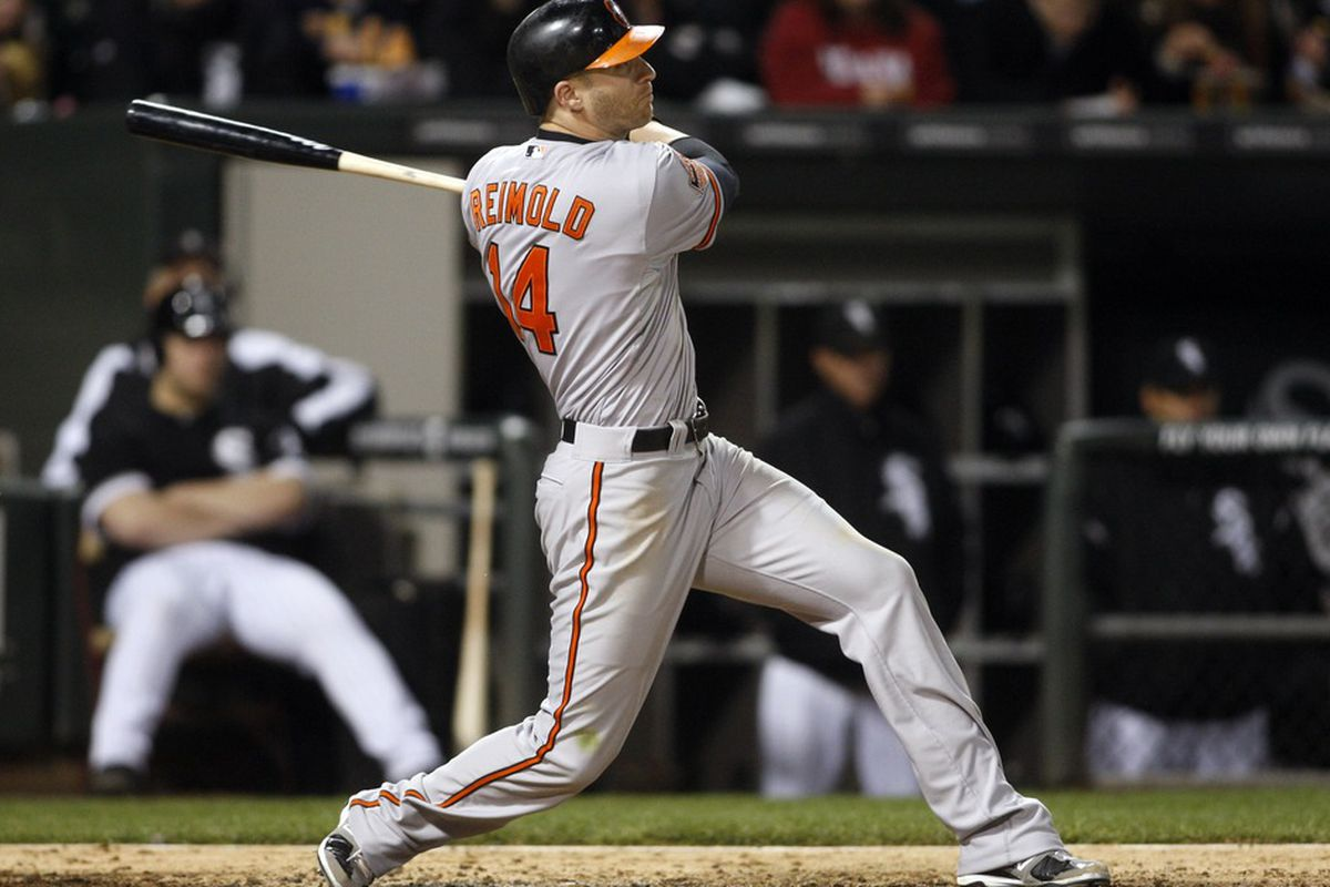 Apr 17, 2012; Chicago, IL, USA; Baltimore Orioles left fielder Nolan Reimold hits a two-run home run during the sixth inning against the Chicago White Sox at US Cellular Field.  Mandatory Credit: Jerry Lai-US PRESSWIRE