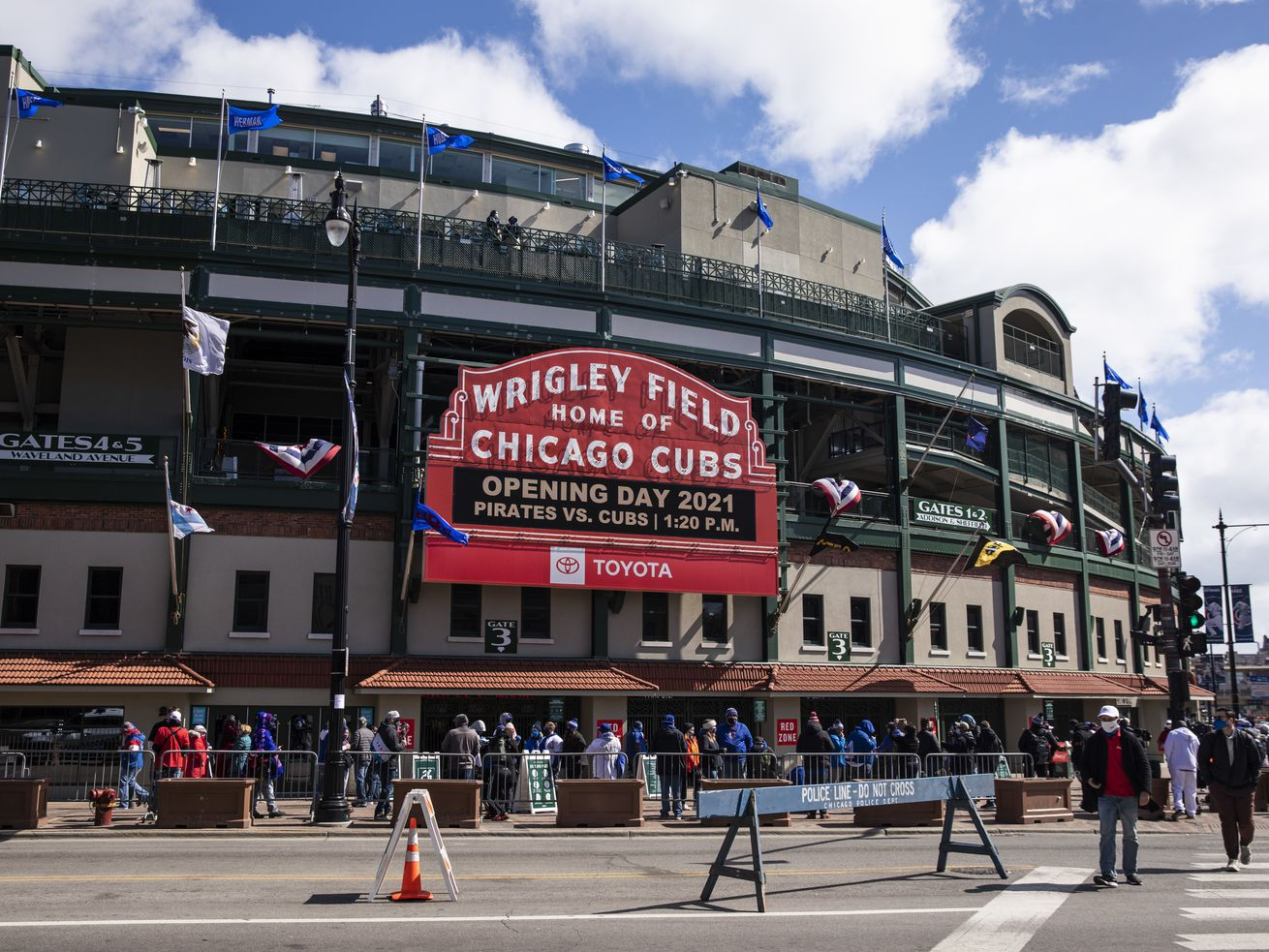 Fans wait to get into Wrigley Field before the Chicago Cubs take on the Pittsburgh Pirates on Opening Day 2021.