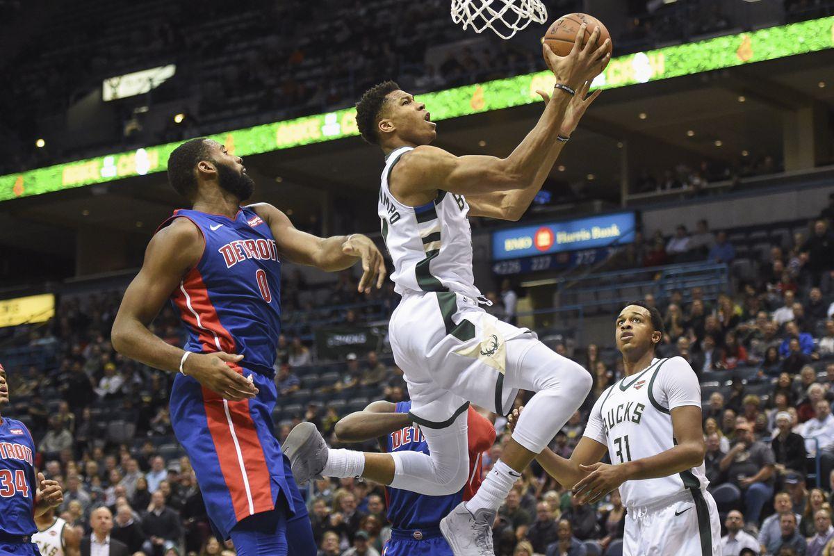 Milwaukee Bucks forward Giannis Antetokounmpo shoots against Detroit Pistons center Andre Drummond in the first quarter at BMO Harris Bradley Center.