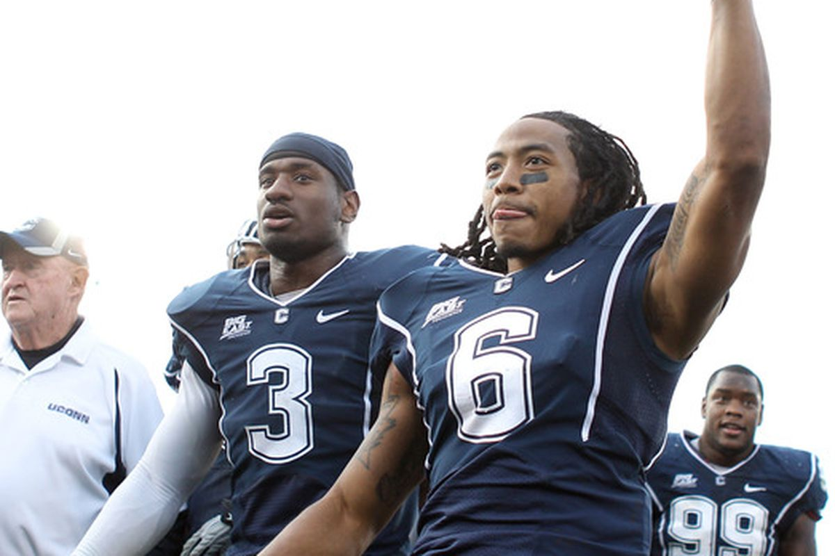 Sio Moore and Kashif Moore, who is wearing Jasper Howard's No. 6 in tribute to his fallen teammate.