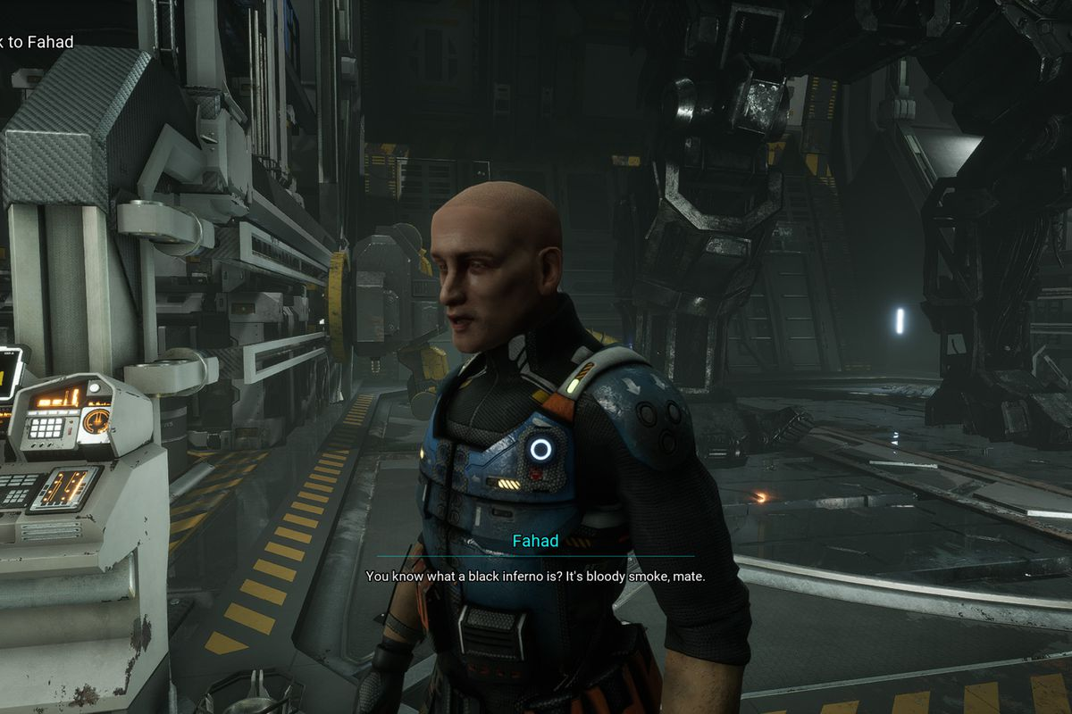 Fahad stands in the 'Mech bay in front of his automated repair terminal.