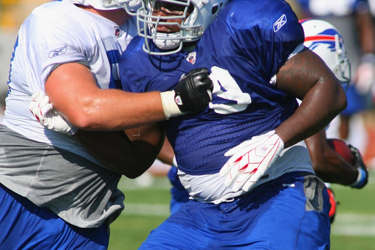 PITTSFORD, NY - AUGUST 08:  Marcell Dareus #99 (blue) of the Buffalo Bills Rushes against Kraig Urbik #60 during Buffalo Bills Training Camp at St. John Fisher College on August 8, 2011 in Pittsford, New York.  (Photo by Rick Stewart/Getty Images)
