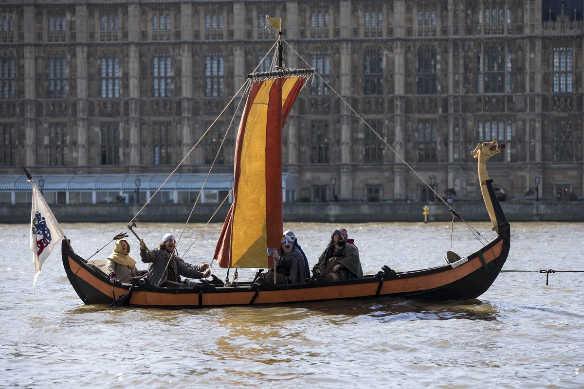Viking Boat Sails Past Houses Of Parliament