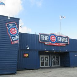 11:56 a.m. The Cubs Store is closed, but still standing, with a W flag still on top -