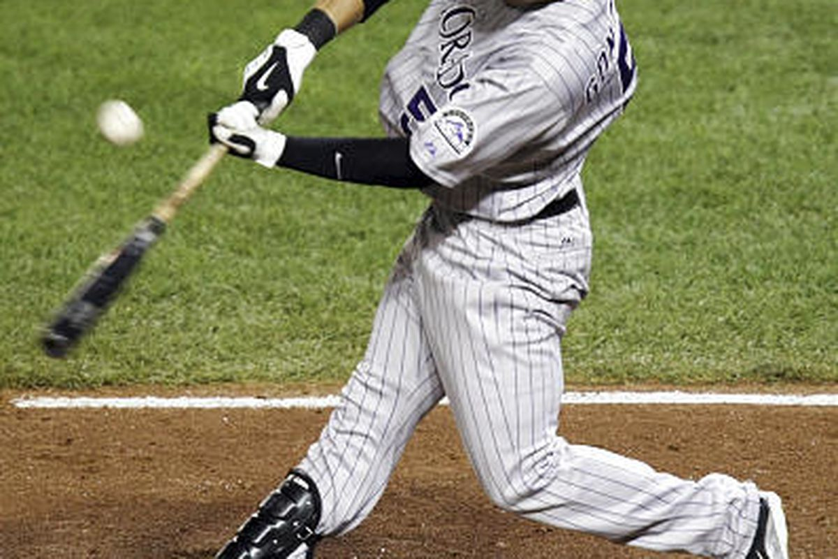 The Rockies' Carlos Gonzalez hits an RBI double against the Washington Nationals.
