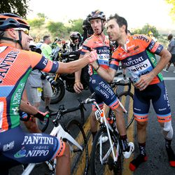 Marco Canola of team Nippo-Vini Fantini-Faizane celebrates with teammate No. 62 Ivan Santaromita after winning Stage 4 of the Tour of Utah in Salt Lake City on Friday, Aug. 16, 2019.