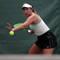 Highland's Dylan Lolofie lines up the ball prior to a hit as she battles Sage Bergeson of Woods Cross for the 5A tennis state championship at Salt Lake Tennis & Health Club on Saturday, Oct. 9, 2021.