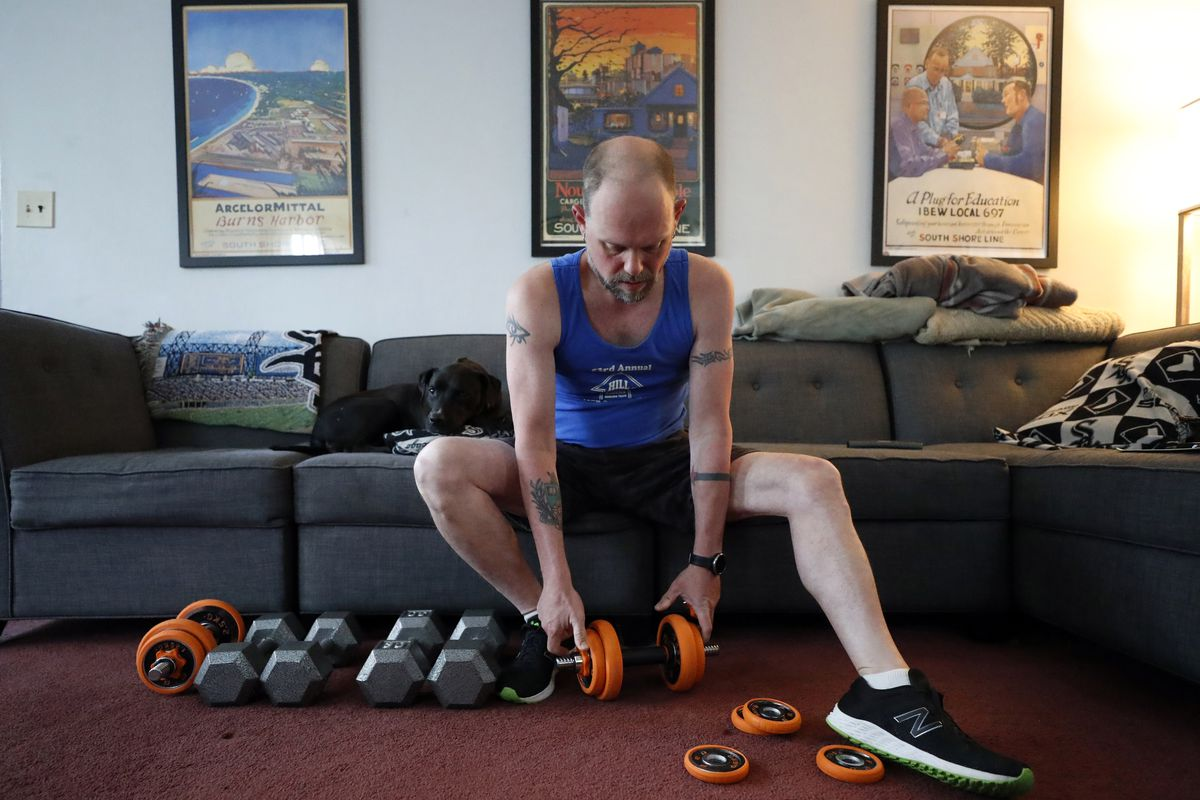 Christian Hainds prepares for a workout session at his home in Hammond, Ind., Monday, June 7, 2021.