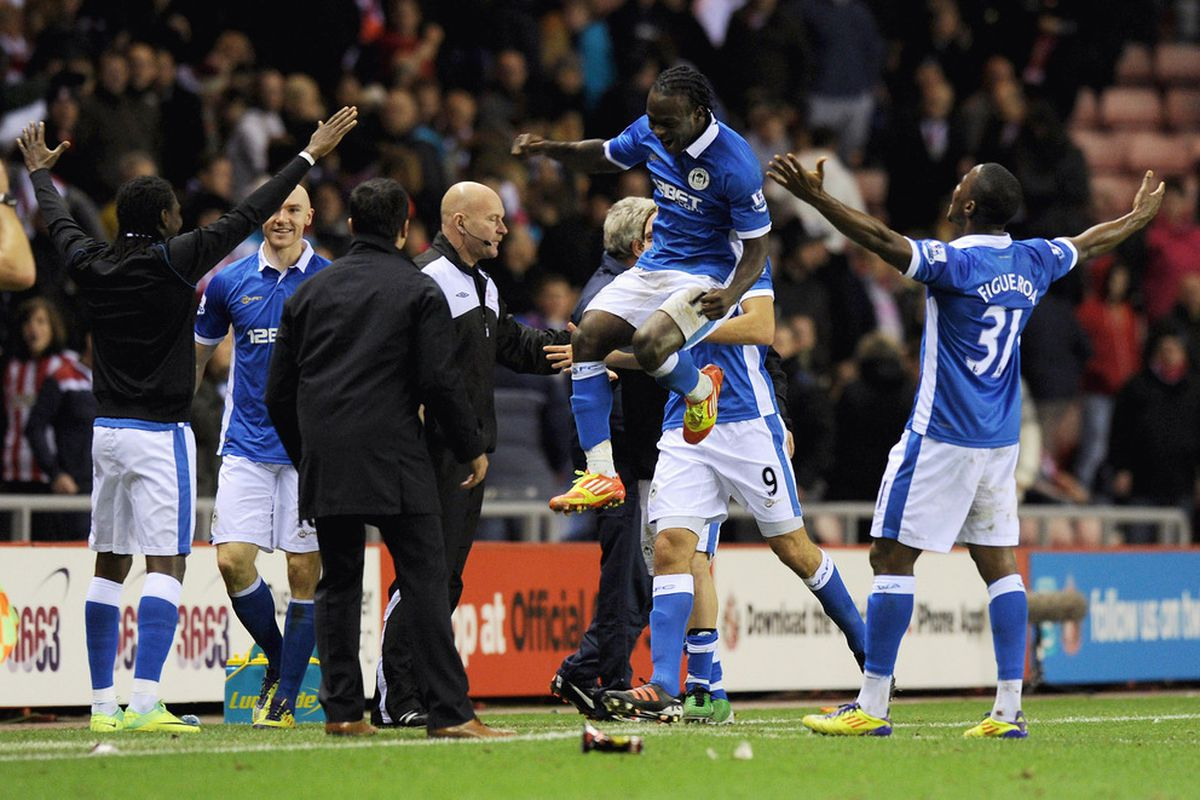 Wigan players celebrate with manager Roberto Martinez after Franco Di Santo scored the winning 2-1 goal during the Barclays Premier League match between Sunderland and Wigan Athletic at Stadium of Light on November 26, 2011