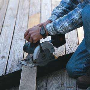 <p>Trim the replacement boards with a circular saw. Using adjacent boards as a cutting guide is faster and more accurate than measuring.</p>