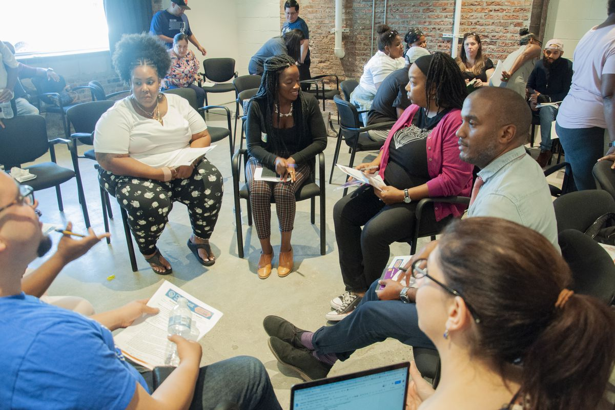 Listening tour attendees split up into a group to have an in-depth discussion on special education in Newark.